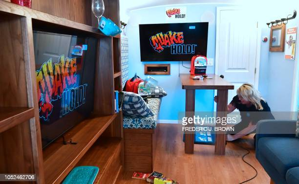 A bowl falls off the shelf as a recreation of the Northridge 68 earthquake strikes for 17 seconds inside the Big Shaker an earthquake simulator while...