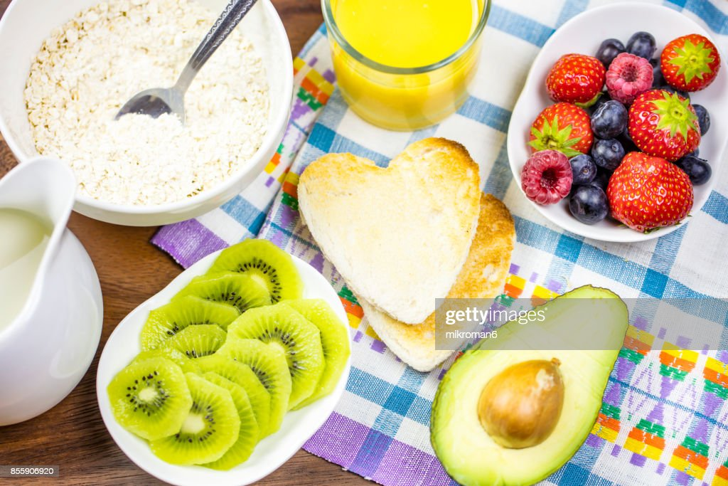 Bowl filled with porridge with fresh berries strawberries and blueberries. Healthy Breakfast : Stock Photo
