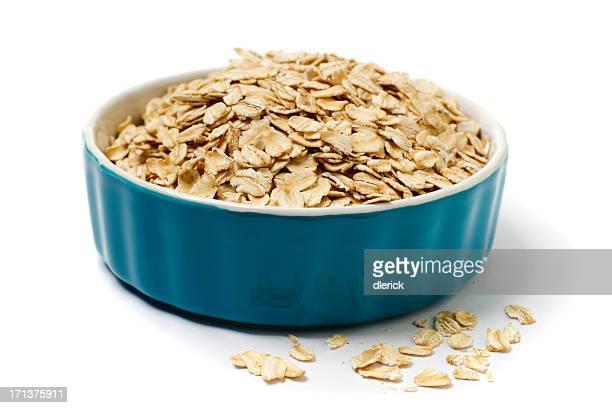 A bowl full of oatmeal flakes.
