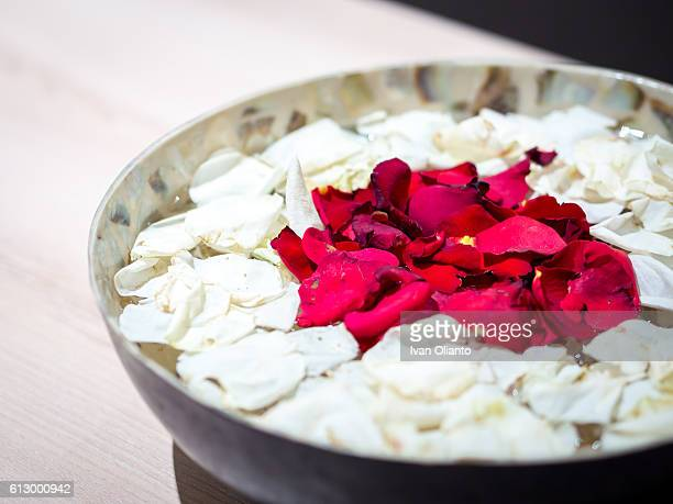 bowl of aromatherapy flower - spa treatment stock pictures, royalty-free photos & images