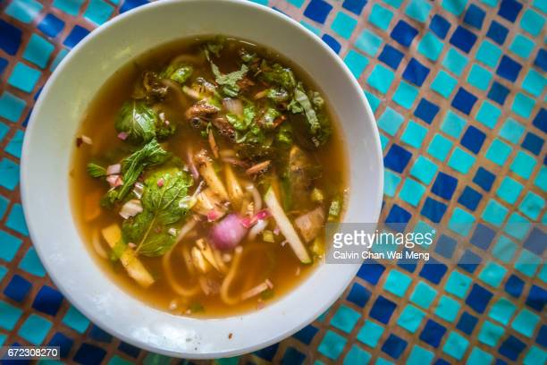 a bowl of asam or penang laksa - george town penang stock photos and pictures