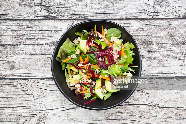 bowl of autumnal salad with lettuce, carrots, avocado, beetroot, pumpkin and sunflower seeds, pomegranate and quinoa - lettuce stock pictures, royalty-free photos & images