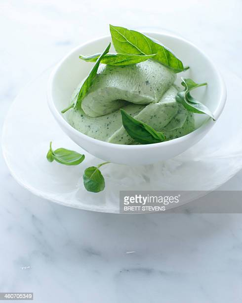 Bowl of basil ice cream with garnish