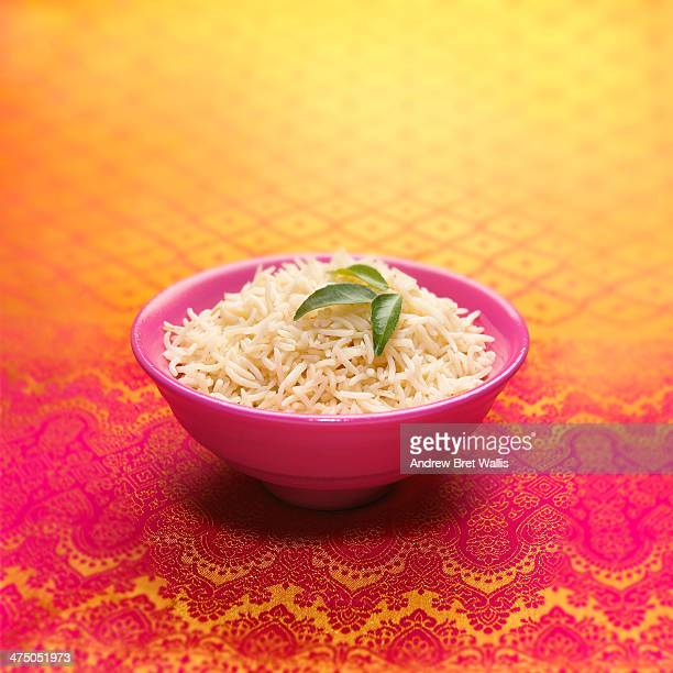 Bowl of basmati rice decorated with curry leaves