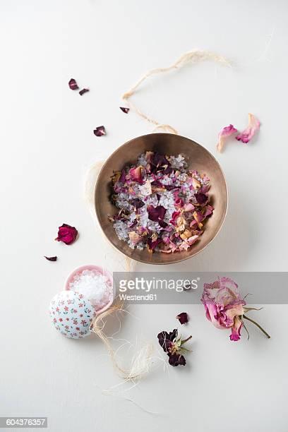 Bowl of bath salts and dried rose petals