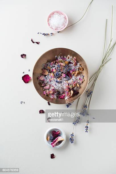 Bowl of bath salts with dried rose petals and lavender blossoms
