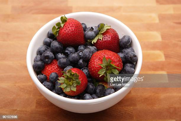 bowl of blueberries and strawberries - lori lee stock pictures, royalty-free photos & images