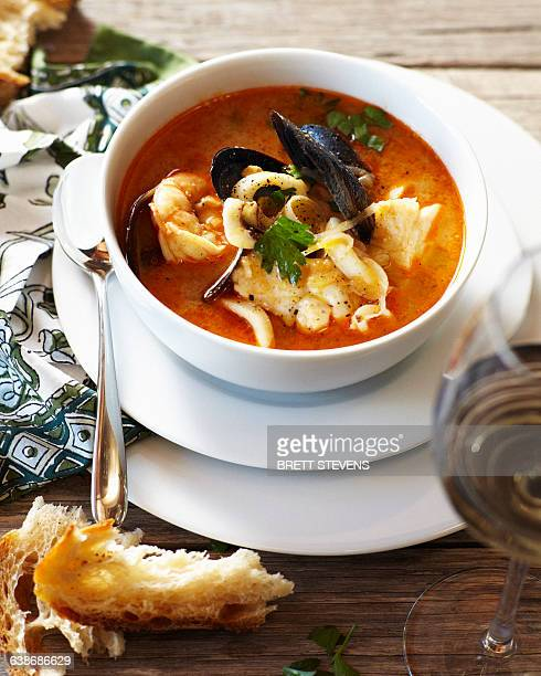 Bowl of bouillabaisse with crusty bread
