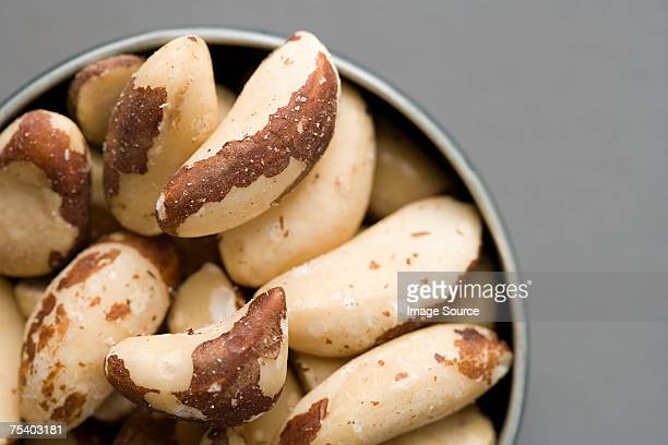 bowl of brazil nuts - brazil nut stock photos and pictures