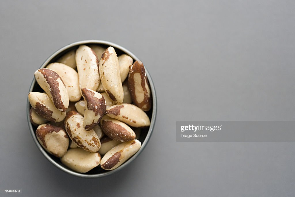 Bowl of brazil nuts : Stock Photo