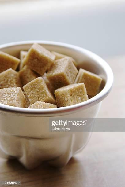 Bowl of brown sugar cubes