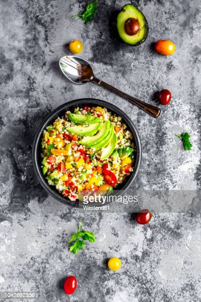 bowl of bulgur salad with bell pepper, tomatoes, avocado, spring onion and parsley - flat leaf parsley stock pictures, royalty-free photos & images