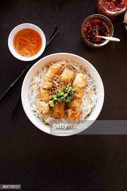Bowl of bun cha gio' with side of chili sauce