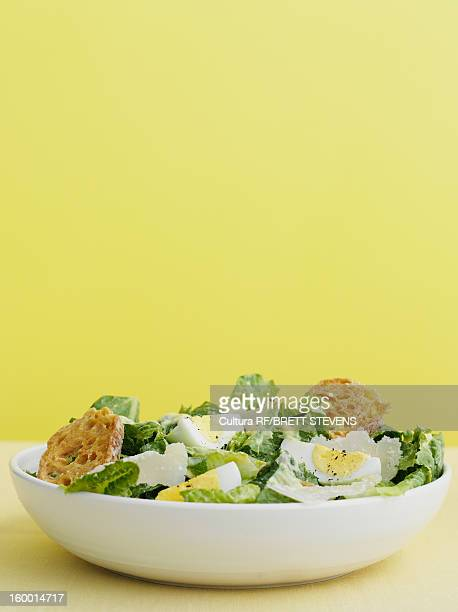 bowl of caesar salad with egg - crouton stock photos and pictures