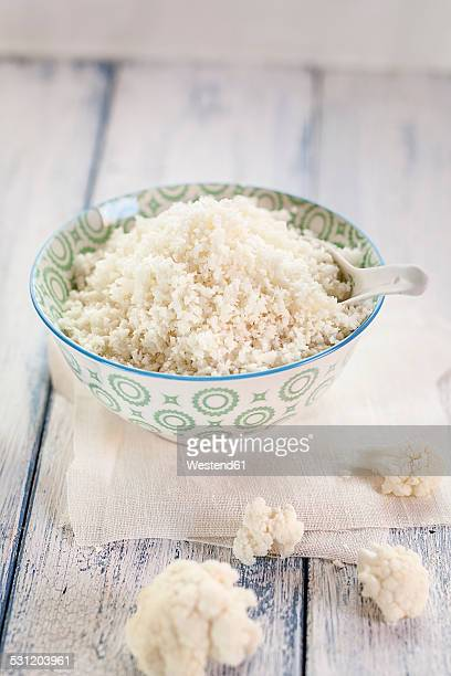 Bowl of cauliflower rice and cauliflower florets