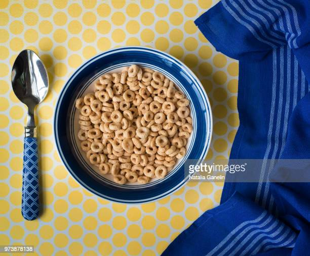 bowl of cereal and blue kitchen towel - bowl stock pictures, royalty-free photos & images
