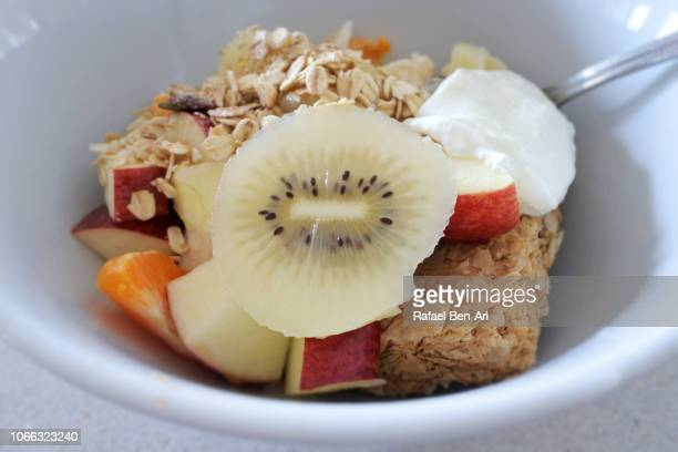 bowl of cereal and fruits - rafael ben ari stock pictures, royalty-free photos & images