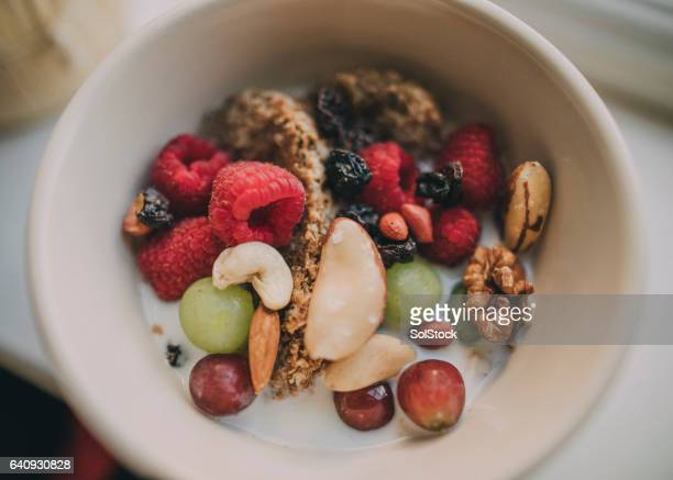 bowl of cereal - nut food stock photos and pictures
