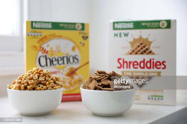 Bowl of Cheerios breakfast cereal and Shreddies cereal, manufactured by Nestle SA, arranged in London, U.K., on Monday, July 26, 2021. Nestle report...