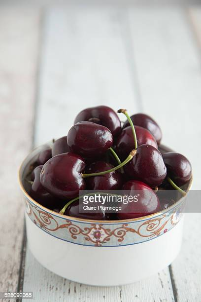 bowl of cherries - claire plumridge stock pictures, royalty-free photos & images