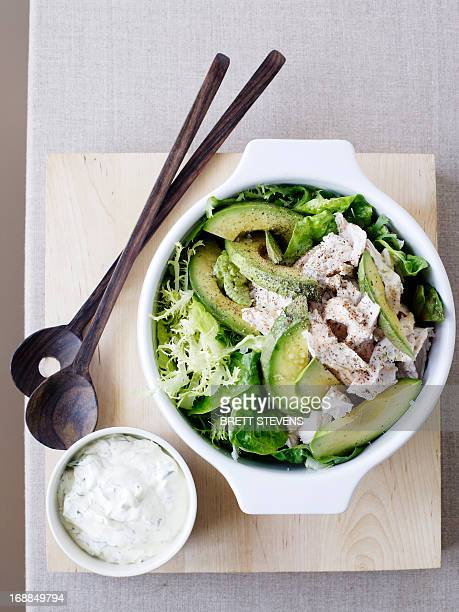 bowl of chicken and avocado salad - salad dressing stock pictures, royalty-free photos & images