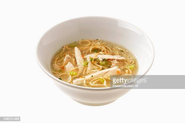 bowl of chicken soup with noodles, close-up - chicken soup stock photos and pictures