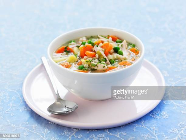 bowl of chicken vegetable soup - chicken soup stock photos and pictures