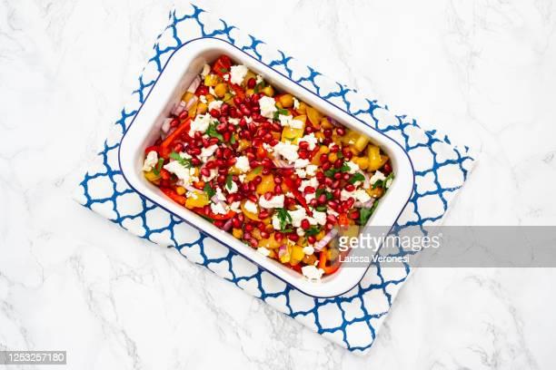bowl of chickpea salad - larissa veronesi stock-fotos und bilder