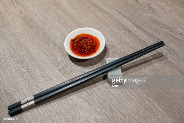 bowl of chinese sichuan spicy sauces aand chopsticks - 調味料 ストックフォトと画像