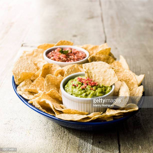 bowl of chips with salsa and guacamole - guacamole stock photos and pictures