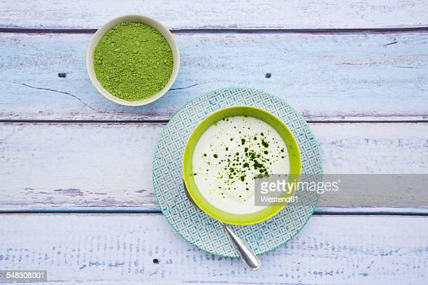 Bowl of chlorella powder and natural yoghurt with chlorella