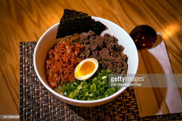 A bowl of Chosun Ramen with sliced Angus ribye bulgogi roasted kimchi seasoned egg and nori in shoyu broth prepared at Sakuramen Ramen Bar in Adams...