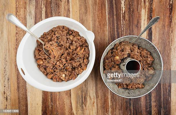 Bowl of Christmas fruit cake ingredient on table