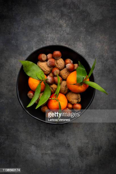 bowl of clementines, walnuts and hazelnut