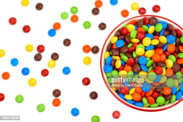 bowl of colorful candies - bowl of candy stock photos and pictures