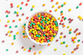 bowl of colorful cereal balls on white background