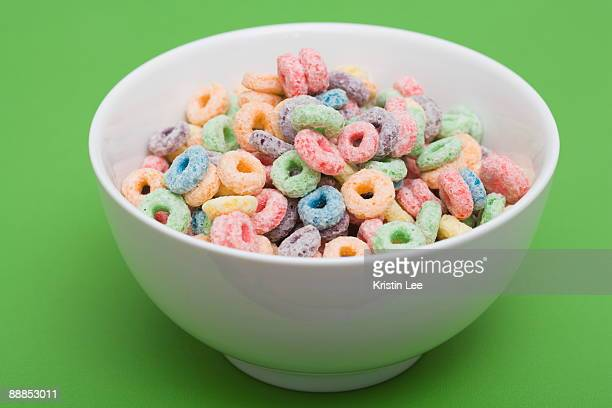 bowl of colorful cereal rings - breakfast cereal stock pictures, royalty-free photos & images