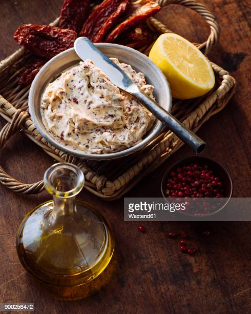 Bowl of compound butter with dried tomatoes and olives