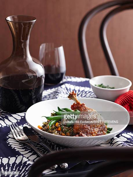 Bowl of confit duck with lentils and green beans