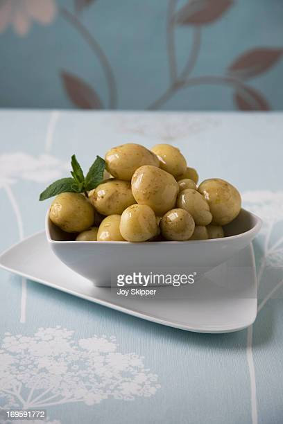 Bowl of cooked Jersey Royal potatoes