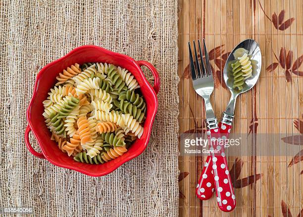 Bowl of cooked pasta and silverware