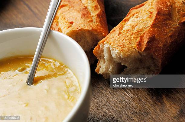 bowl of country vegetable soup with French stick bread