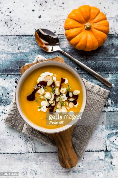 bowl of creamed pumpkin soup - soup stock pictures, royalty-free photos & images