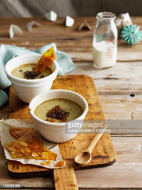 Bowl of custard with nut brittle