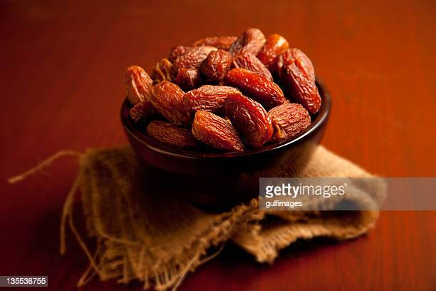 Bowl of dates on top of a native place mat