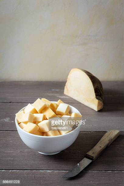 bowl of diced swede and kitchen knife - rutabaga stock pictures, royalty-free photos & images