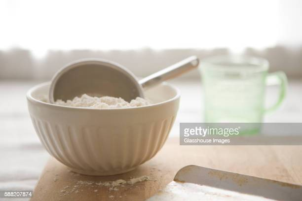 bowl of flour - measuring cup stock pictures, royalty-free photos & images