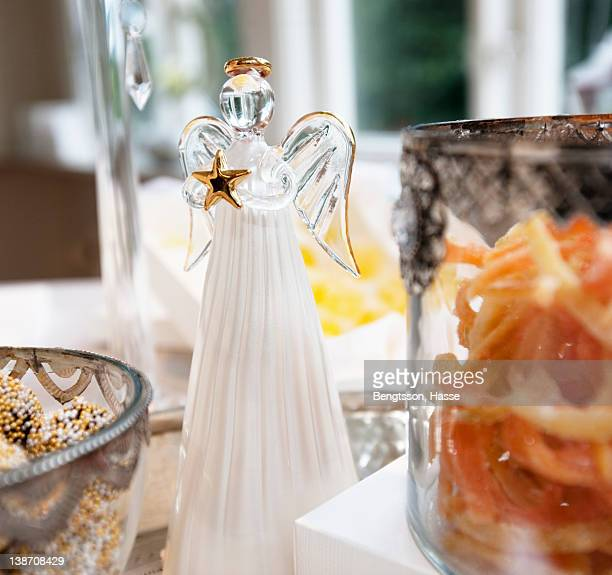 Bowl of food with Christmas angel, close-up