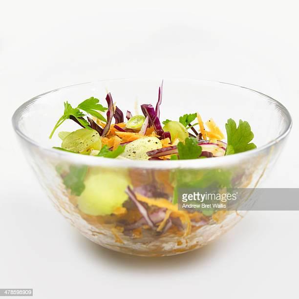 Bowl of fresh fruit salad against white