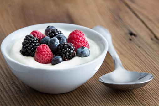Bowl of fresh mixed berries and yogurt 487468481